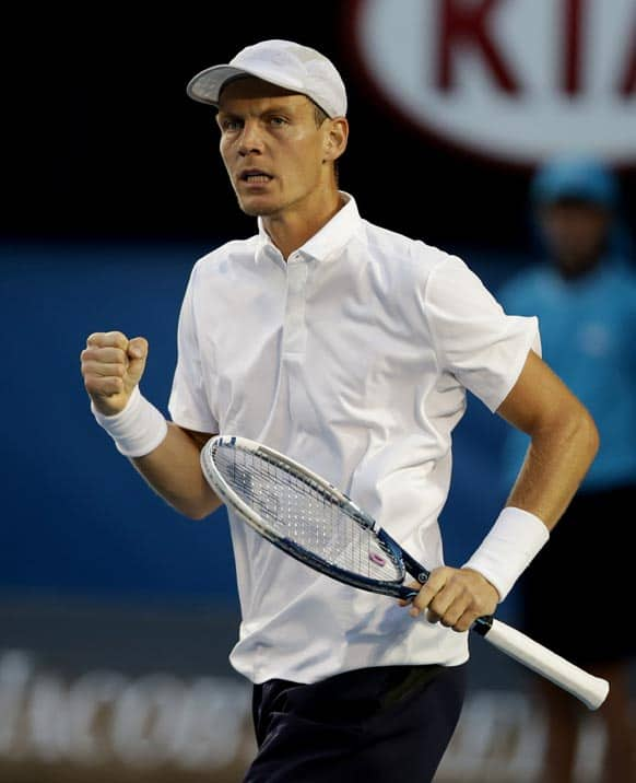 Tomas Berdych of the Czech Republic reacts during his quarterfinal match against Serbia's Novak Djokovic at the Australian Open tennis championship in Melbourne.