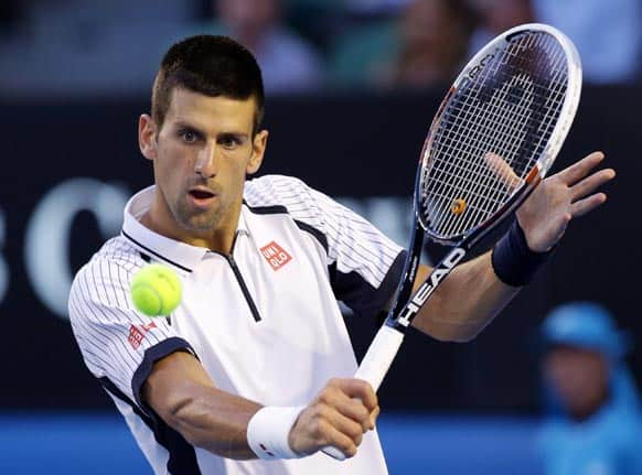 Serbia's Novak Djokovic hits a return to Tomas Berdych of the Czech Republic during their quarterfinal match at the Australian Open tennis championship in Melbourne.