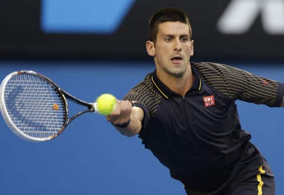 Serbia's Novak Djokovic hits a forehand return to Spain's David Ferrer during their semifinal match at the Australian Open tennis championship.