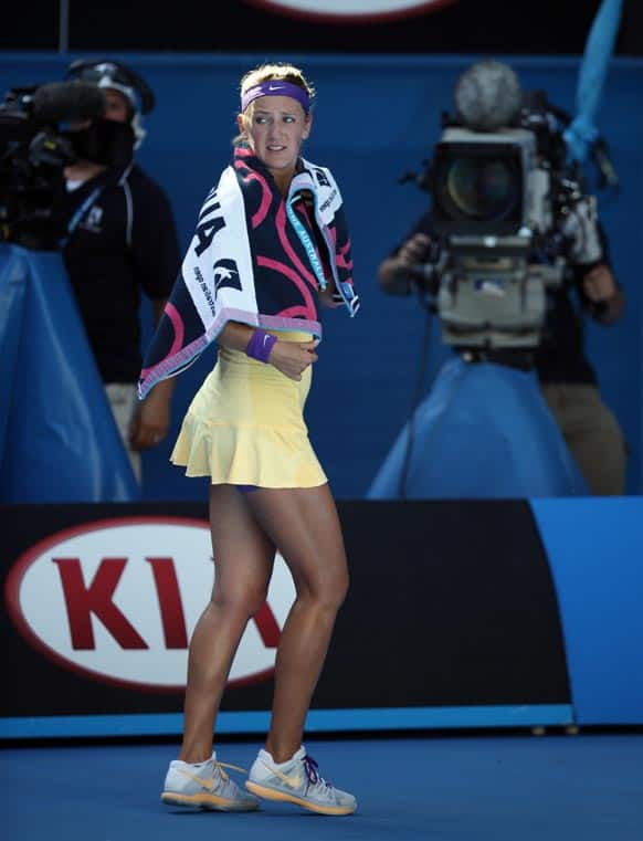 Victoria Azarenka of Belarus walks off the court to take a medical time out during her semifinal match against Sloane Stephens of the US at the Australian Open tennis championship in Melbourne, Australia.