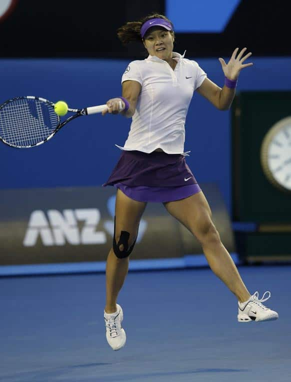 China's Li Na hits a forehand return to Victoria Azarenka of Belarus during the women's final at the Australian Open tennis championship in Melbourne.