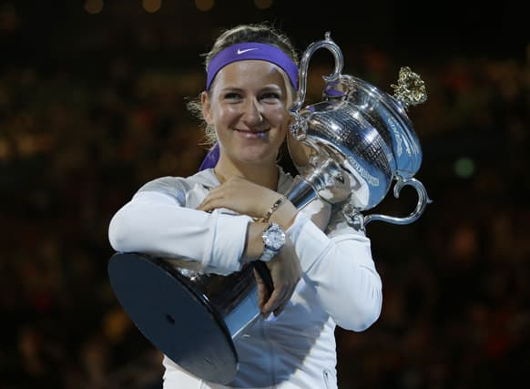 Victoria Azarenka of Belarus hugs her trophy after winning the women's final against China's Li Na at the Australian Open tennis championship in Melbourne.