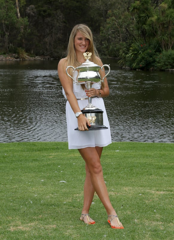 Victoria Azarenka of Belarus poses with the Australian Open trophy in the Royal Botanical Gardens following her win over China's Li Na in the women's final in Melbourne.