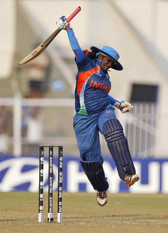 India's Thirush Kamini Murugesan celebrates after scoring a century against West Indies during the opening match of the ICC Women's World Cup cricket in Mumbai.
