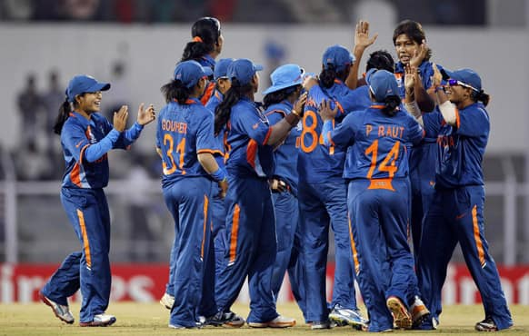 Indian cricketers celebrate the dismissal of West Indies' Kycia Knight during the opening match of the ICC Women's World Cup in Mumbai.