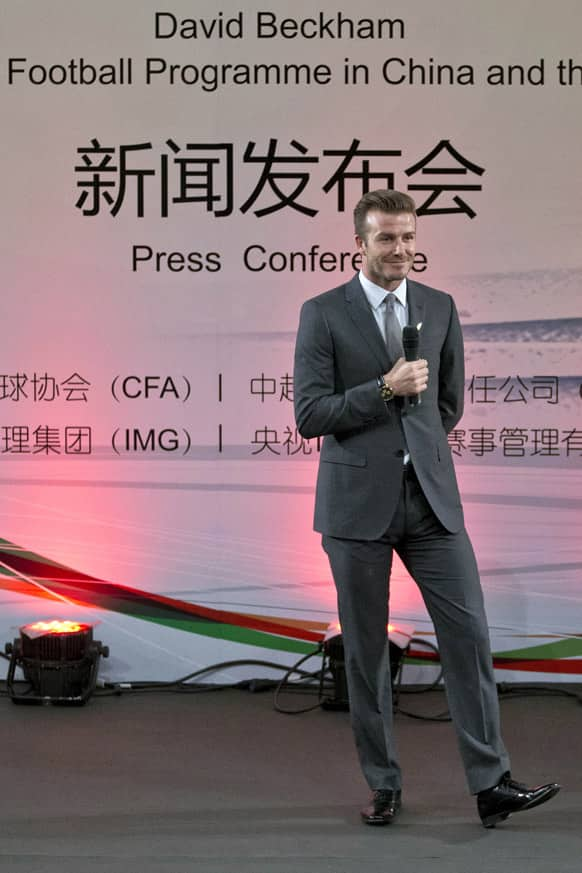 David Beckham speaks during an event to promote soccer games and Chinese soccer league at Shijia Primary School in Beijing.