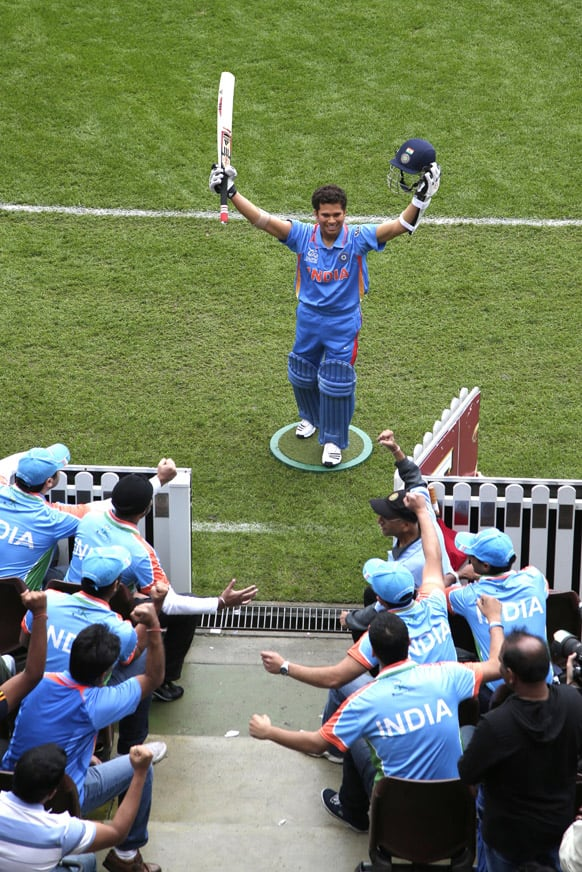 Indian cricket fans pretend to cheer for a wax statue of Sachin Tendulkar at the SCG in Sydney.