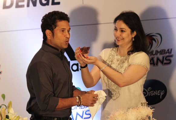 Anjali Tendulkar, wife of Sachin Tendulkar, offers him a piece of cake during celebration of his 40th birthday in Kolkata.