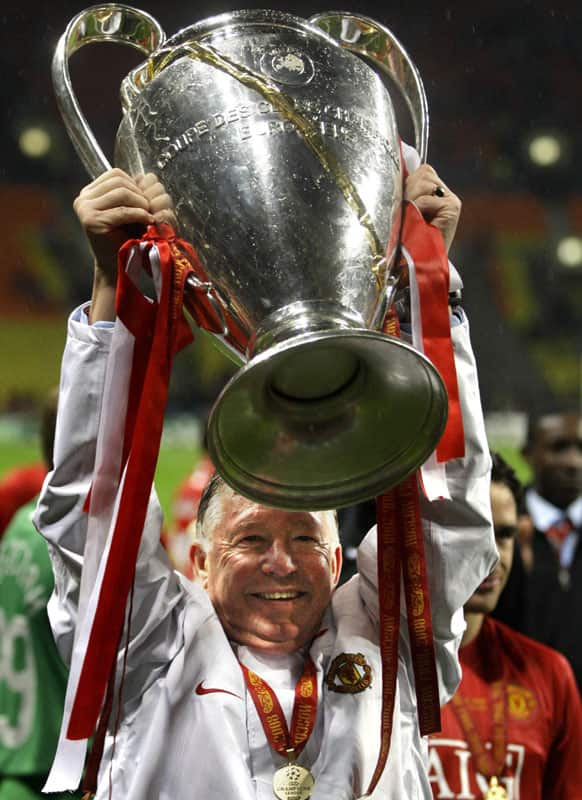 In this Wednesday May 21, 2008 file photo Manchester United's manager Alex Ferguson celebrates with the trophy after winning the Champions League final soccer match at the Luzhniki Stadium in Moscow.