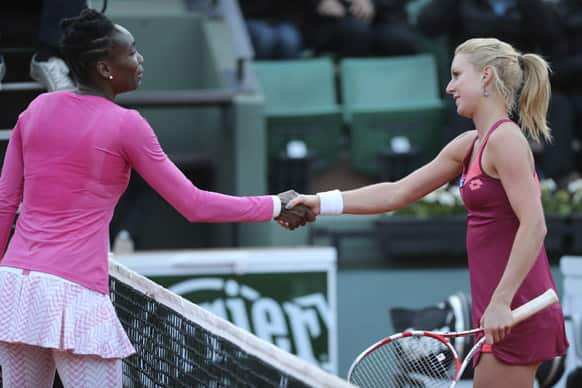 Venus Williams of the US, congratulates Poland's Urszula Radwanska with her first round match win of the French Open tennis tournament, at Roland Garros stadium in Paris.