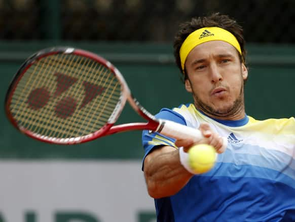Argentina's Juan Monaco returns the ball to Spain's Daniel Gimeno Traver during their first round match of the French Open tennis tournament at the Roland Garros stadium in Paris.