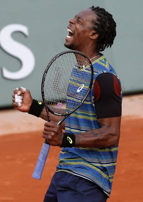 France's Gael Monfils reacts shortly before defeating Czech Republic's Tomas Berdych during their first round match of the French Open tennis tournament at the Roland Garros stadium in Paris.