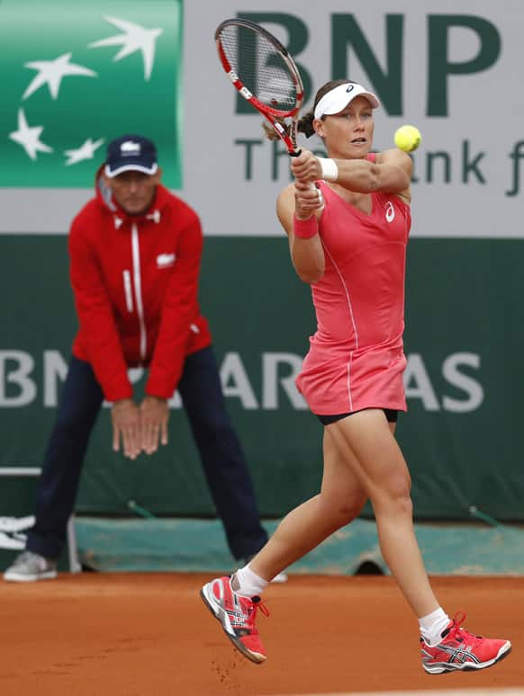 Australia's Samantha Stosur returns the ball to Japan's Kimiko Date-Krumm during their first round match of the French Open tennis tournament at the Roland Garros stadium.