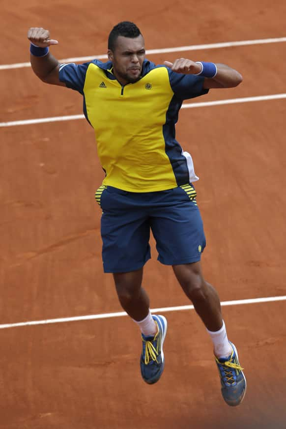 France's Jo-Wilfried Tsonga celebrates winning against Finland's Jarkko Nieminen in their second round match of the French Open tennis tournament, at Roland Garros stadium in Paris.