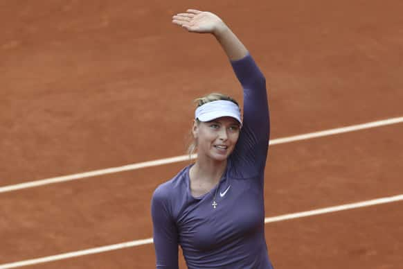Russia's Maria Sharapova greets spectators after winning her second round match against Canada's Eugenie Bouchard at the French Open tennis tournament, at Roland Garros stadium in Paris.