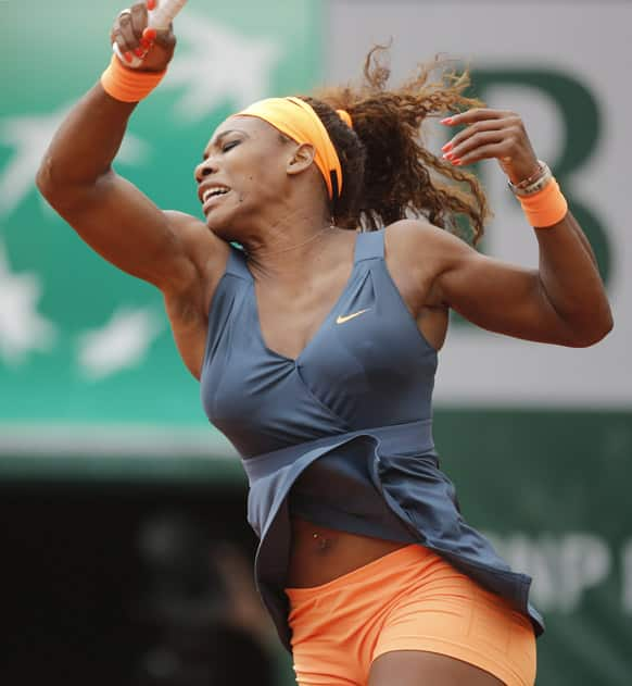 Serena Williams of the returns against Sorana Cirstea of Romania in their third round match at the French Open tennis tournament, at Roland Garros stadium in Paris.