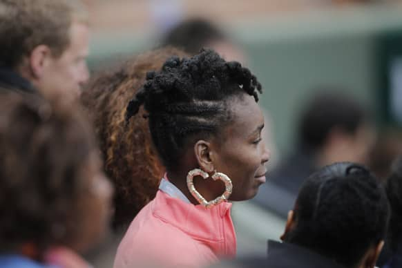Venus Williams of the US watches her sister Serena's third round match against Sorana Cirstea of Romania at the French Open tennis tournament, at Roland Garros stadium in Paris.