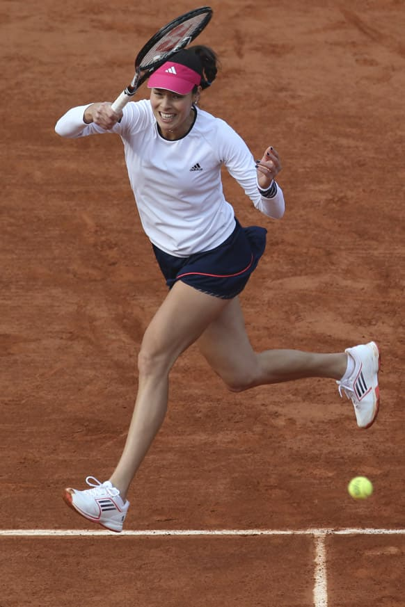 Serbia's Ana Ivanovic returns against Virginie Razzano of France in their third round match at the French Open tennis tournament, at Roland Garros stadium in Paris.