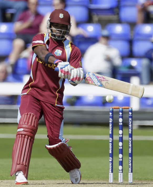 West Indies's Darren Bravo bats a ball bowled by Australia's James Faulkner, unseen, during a warm up cricket match for the upcoming ICC Champions Trophy, in Cardiff, Wales.