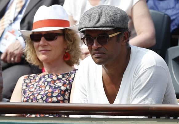 Former Roland Garros winner and musician Yannick Noah watches Russia's Maria Sharapova defeat Serbia's Jelena Jankovic in three sets 0-6, 6-4, 6-3, in their quarterfinal match at the French Open tennis tournament, at Roland Garros stadium in Paris.