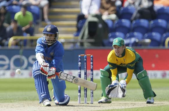 Shikhar Dhawan hits four runs off the bowling of South Africa's JP Duminy during their group stage ICC Champions Trophy cricket match in Cardiff, Wales.