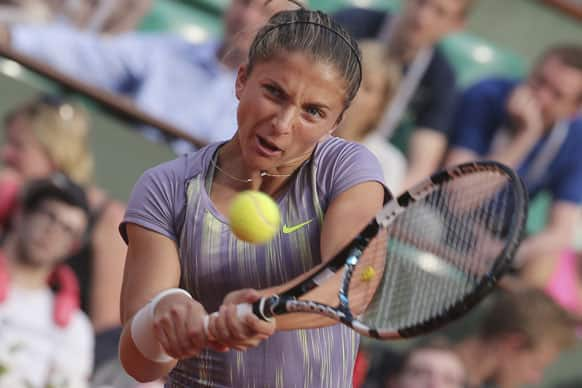 Italy's Sara Errani returns against Serena Williams of the US in their semifinal match at the French Open tennis tournament, at Roland Garros stadium in Paris.