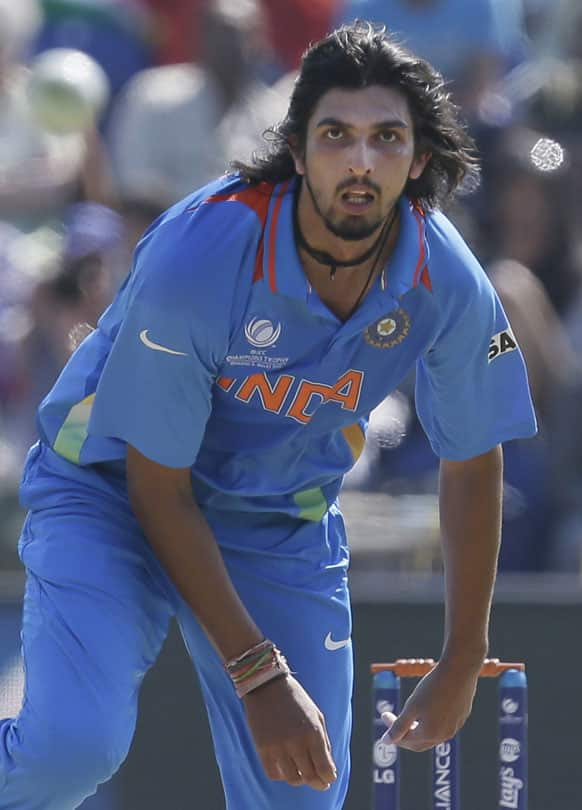 Ishant Sharma looks down the wicket after he bowls to South Africa's AB de Villiers during their group stage ICC Champions Trophy cricket match in Cardiff, Wales.
