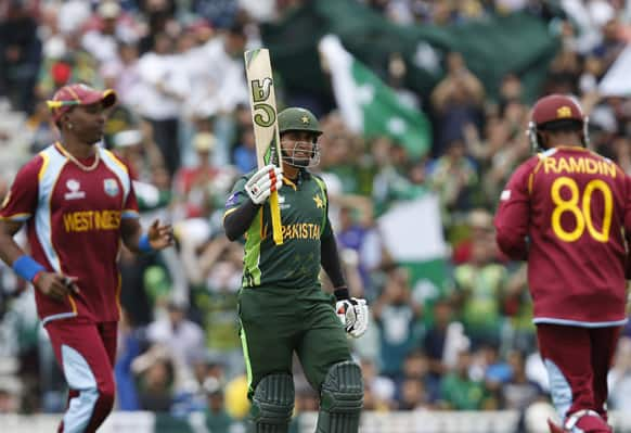 Pakistan's Nasir Jamshed reacts to his 50 runs against West Indies during their ICC Champions Trophy group B cricket match at the Oval cricket ground in London.