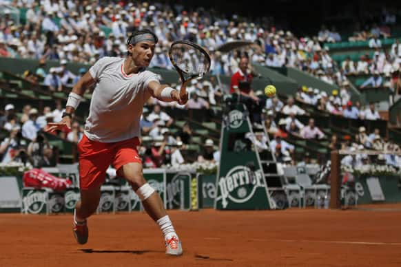 Spain's Rafael Nadal returns against Serbia's Novak Djokovic in their semifinal match at the French Open tennis tournament, at Roland Garros stadium in Paris.