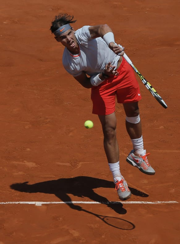 Spain's Rafael Nadal returns the ball to Serbia's Novak Djokovic during their semifinal match of the French Open tennis tournament at the Roland Garros stadium in Paris.