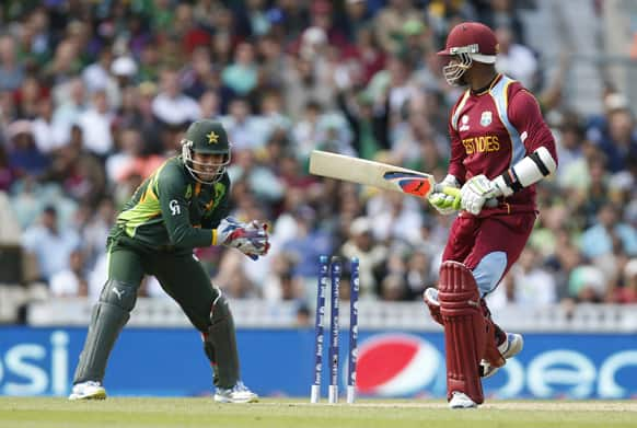 Marlon Samuels watches as he is being stumped by Pakistan's wicket keeper Kamran Akmal during their ICC Champions Trophy group B cricket match at the Oval cricket ground in London.
