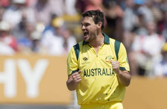 Australia's Clint McKay celebrates taking the wicket of England's Joe Root, not pictured, during the ICC Champions Trophy group A cricket match between England and Australia at Edgbaston cricket ground in Birmingham, England.