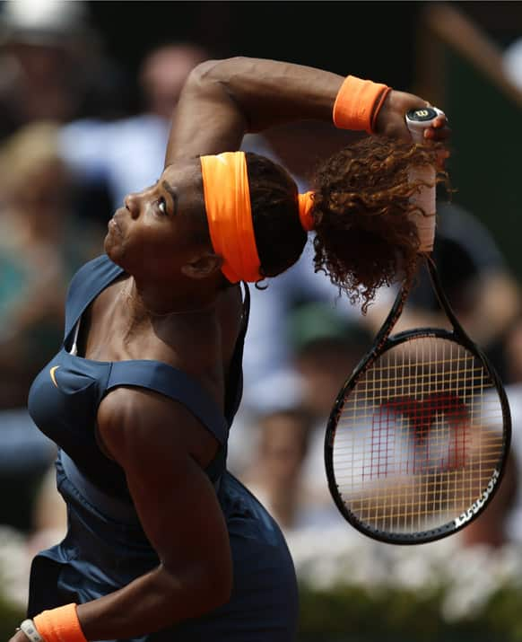 Serena Williams, of the US, serves the ball to Russia's Maria Sharapova during the Women's final match of the French Open tennis tournament at the Roland Garros stadium in Paris.