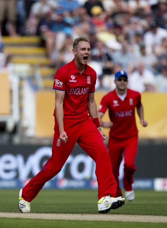England's Stuart Broad celebrates taking the wicket of Australia's David Warner, not pictured, during the ICC Champions Trophy group A cricket match between England and Australia at Edgbaston cricket ground in Birmingham.
