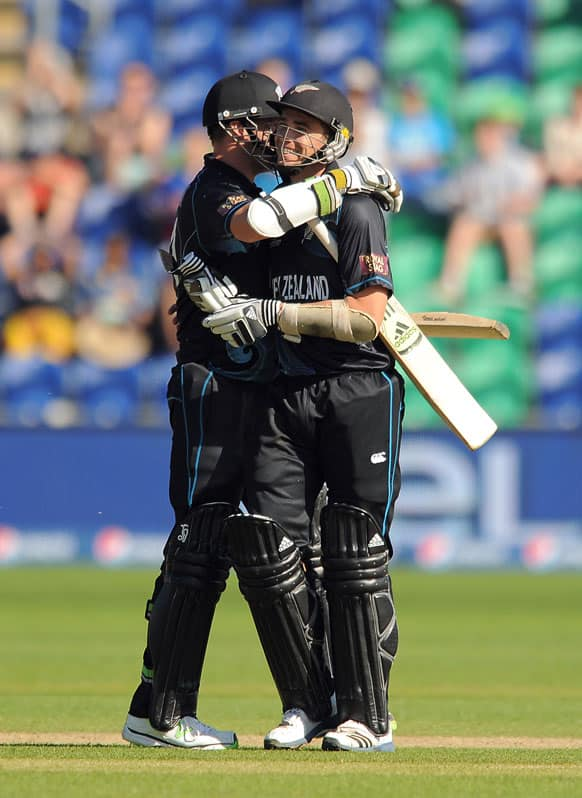 New Zealand's Mitchell McClenaghan, left, and team mate Tim Southee congratulate each other after they win the ICC Champions Trophy match at the SWALEC Stadium.