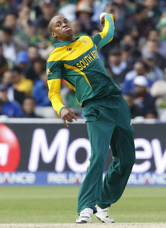 South Africa's Aaron Phangiso bowls during an ICC Champions Trophy cricket match between Pakistan and South Africa at Edgbaston in Birmingham.