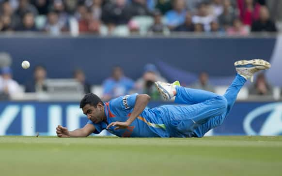 Ravichandran Ashwin fails to take a catch off his own bowling during the ICC Champions Trophy group B cricket match between India and West Indies at The Oval cricket ground in London.