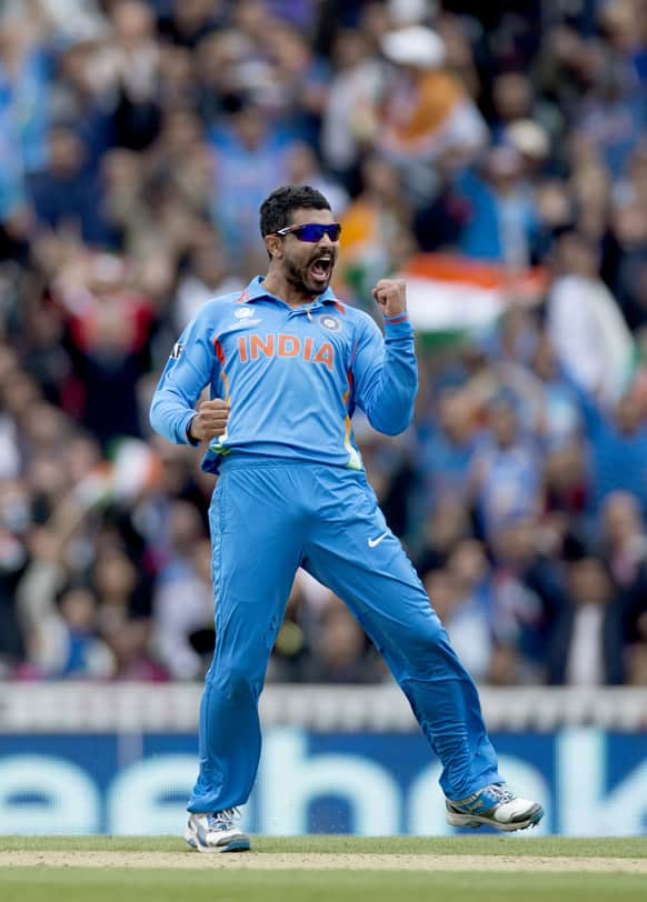 Ravindra Jadeja celebrates taking the wicket of West Indies' Johnson Charles, not pictured, during the ICC Champions Trophy group B cricket match between India and West Indies at The Oval cricket ground in London.