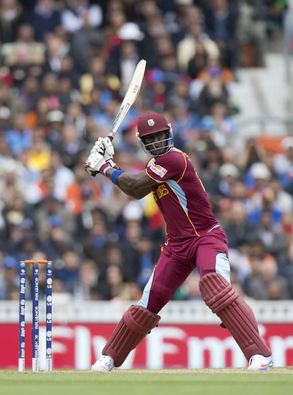 West Indies' Darren Sammy prepares to hit a shot during the ICC Champions Trophy group B cricket match between India and West Indies at The Oval cricket ground in London.