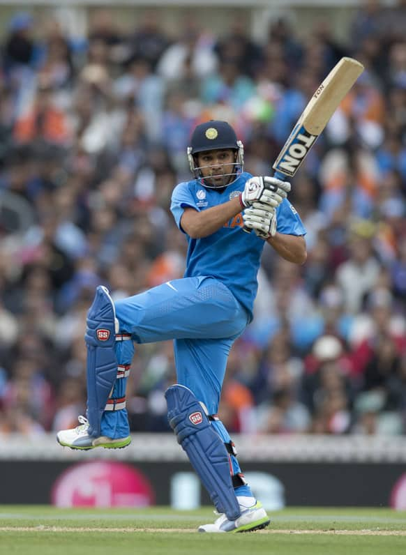 Rohit Sharma hits a shot during the ICC Champions Trophy group B cricket match between India and West Indies at The Oval cricket ground in London.