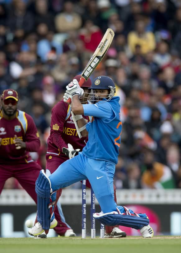 Shikhar Dhawan hits a shot during the ICC Champions Trophy group B cricket match between India and West Indies at The Oval cricket ground in London.