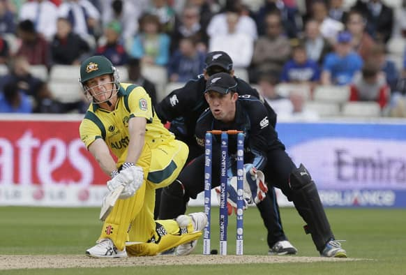 Australia's George Bailey hits a ball bowled by New Zealand's Daniel Vettori, unseen, during their group stage ICC Trophy cricket match at Edgbaston, Birmingham, England.