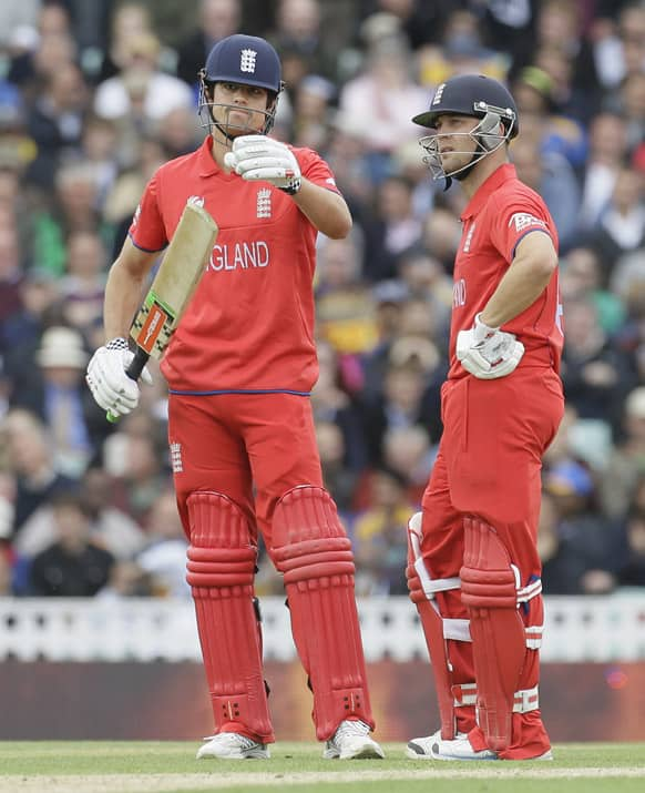 England's Alastair Cook and teammate Jonathan Trott wait for a tv replay and 3rd umpire decision on his lbw appeal by Sri Lanka's bowler Rangana Herath, he was given out, during their ICC Champions Trophy cricket match at the Oval cricket ground in London.
