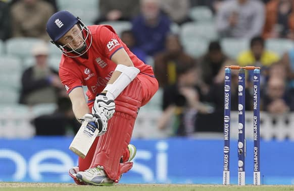 England's Joe Root hits a ball for four runs off the bowling of Sri Lanka's Shaminda Eranga during their ICC Champions Trophy cricket match at the Oval cricket ground in London.