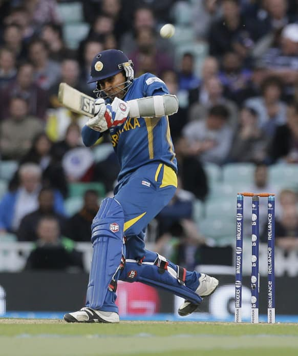 Sri Lanka's Mahela Jayawardena hits a ball bowled by England's James Anderson, that is caught on the boundary by a substitute fielder during their ICC Champions Trophy cricket match at the Oval cricket ground in London.