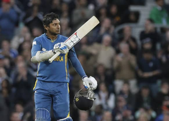 Sri Lanka's Kumar Sangakkara celebrates reaching his century against England during their ICC Champions Trophy cricket match at the Oval cricket ground in London.