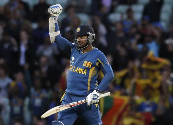 Sri Lanka's Kumar Sangakkara punches the air after he hit the winning runs to defeat England in their ICC Champions Trophy cricket match at the Oval cricket ground in London. Kumar Sangakkara hit an unbeaten 134 not out in the match.