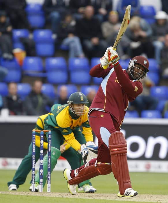West Indies' Chris Gayle plays a shot off the bowling of South Africa's Jean-Paul Duminy during an ICC Champions Trophy cricket match between West Indies and South Africa at the Cardiff Wales Stadium in Cardiff.