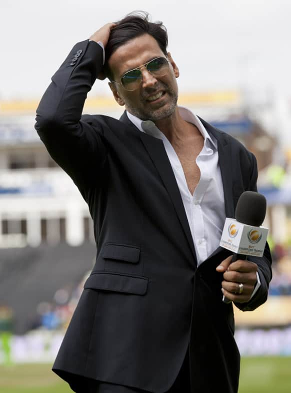 Akshay Kumar waits to be interviewed during India's ICC Champions Trophy cricket match against Pakistan at Edgbaston cricket ground.