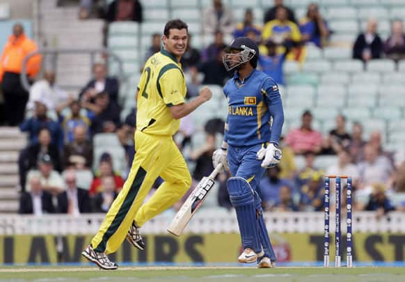 Kumar Sangakkara, right, begins to walk off the pitch after being given out caught by Australia' Glenn Maxwell, off the bowling of Clint McKay who is seen reacting, left, during their ICC Champions Trophy cricket match at the Oval cricket ground in London.